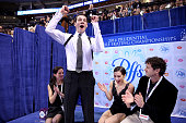 Simon Shnapir and Marissa Castelli with their coaches Carrie Wall and Bobby Martin celebrate in the kiss and cry after skating in the pairs free...