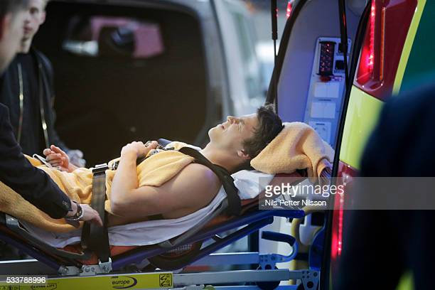 Simon Skrabb of Gefle IF leaves the arena in an ambulance after the Allsvenskan match between Gefle IF and AIK at Gavlevallen on May 23 2016 in Gavle...