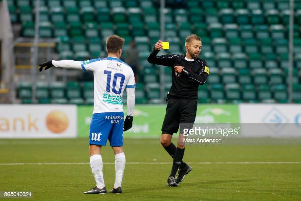 Simon Skrabb of IFK Norrkoping is shown a yellow card during the Allsvenskan match between GIF Sundsvall and IFK Norrkoping at Idrottsparken on...