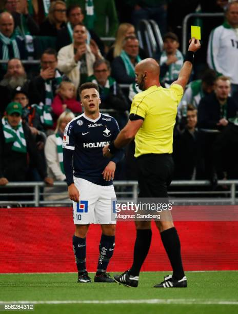 Simon Skrabb of IFK Norrkoping receives yellow card by Jonas Eriksson referee during the Allsvenskan match between Hammarby IF and IFK Norrkoping at...