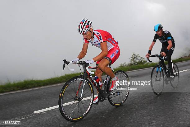Simon Spilak of Slovakia and Team Katusha is closely followed by Chris Froome of Great Britain and Team Sky during the last category one climb during...