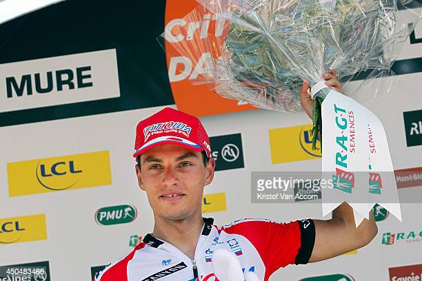 Simon Spilak of Slovenia and Team Katusha celebrates on the podium after winning the fifth stage of the Criterium du Dauphine on June 12 2014 between...