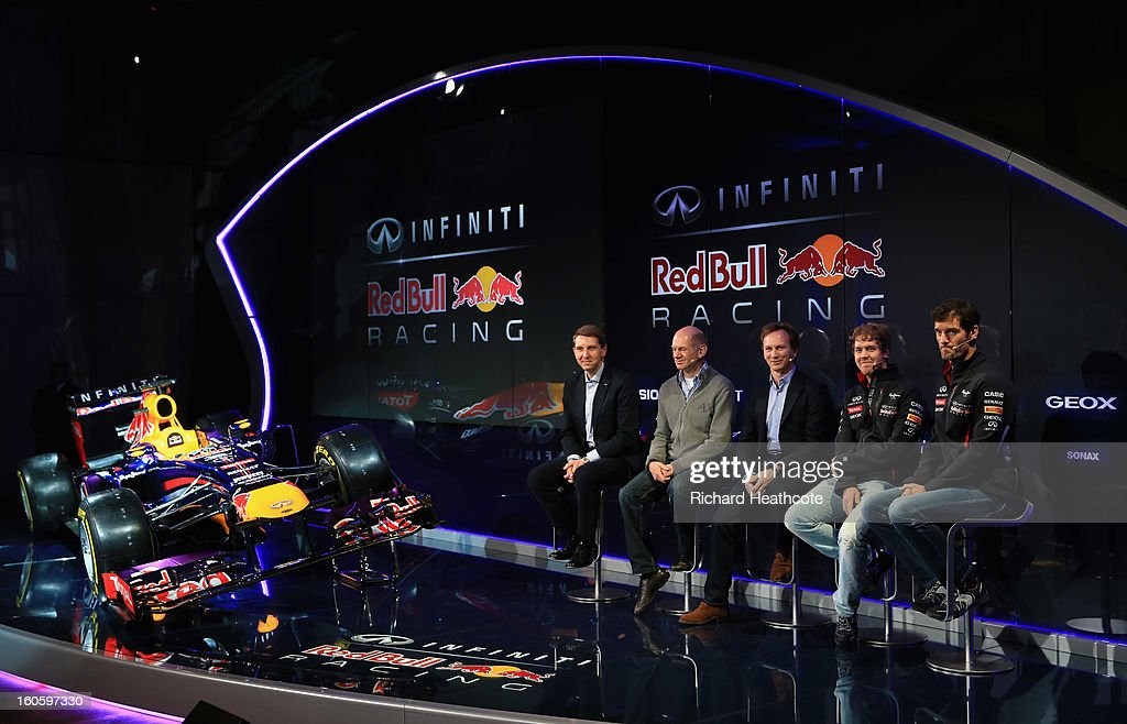 Simon Sproule, Infiniti Corporate Vice-President Global Marketing, Adrian Newey, Chief Technical Officer, Christian Horner, Team Principle, Mark Webber of Australia, and Sebastian Vettel of Germany talk to the guests during the Infiniti Red Bull Racing RB9 launch on February 3, 2013 in Milton Keynes, England.