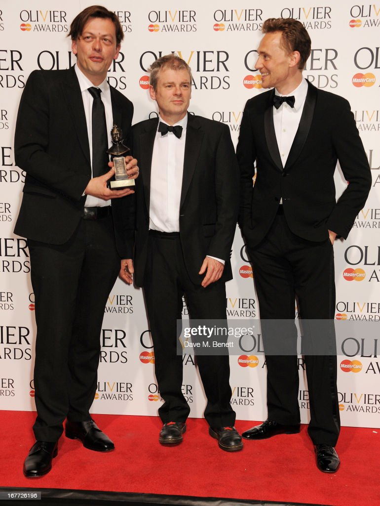 Simon Stephens, Mark Haddon and Tom Hiddleston pose in the press room with the Mastercard Best New Play award at The Laurence Olivier Awards 2013 at The Royal Opera House on April 28, 2013 in London, England.
