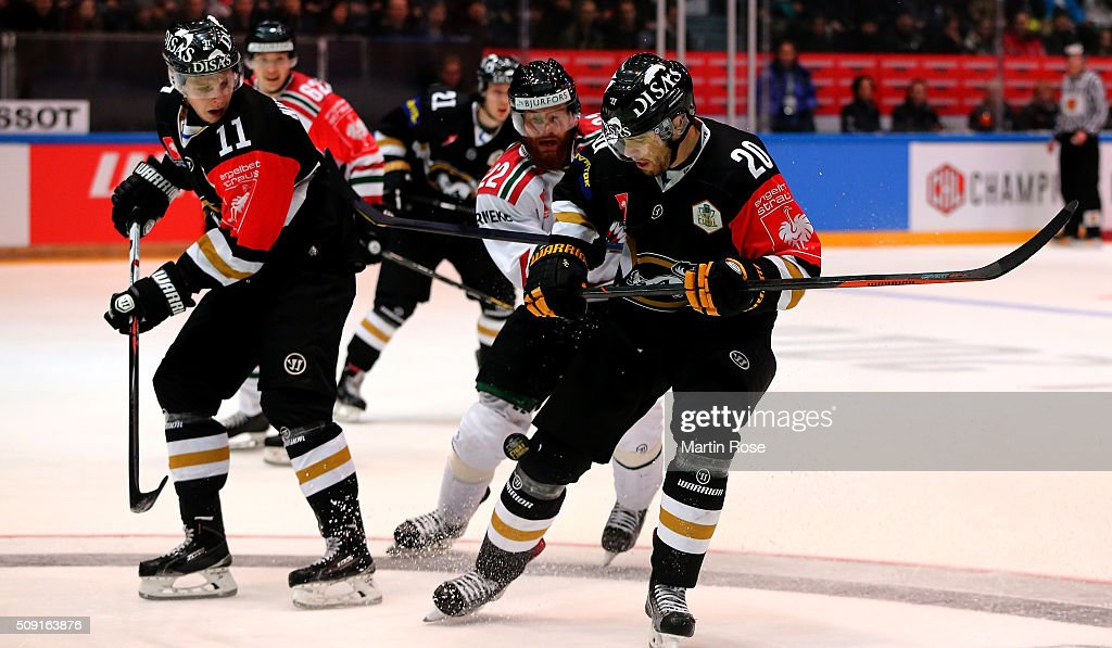 Simon Suoranta #20 of Oulu and Robin Figren #22 of Gothenburg battle for the puck during the Champions Hockey League final game between Karpat Oulu and Frolunda Gothenburg at Oulun Energia-Areena on February 9, 2016 in Oulu, Finland.