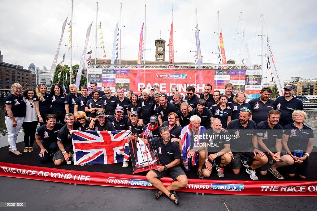 Simon Talbot (front C), the skipper of the Great Britain yacht, celebrates with his crew in Saint Katherine's Dock in London, England after taking the second position in the 2013-14 Clipper Round the World Yacht Race, on July 12, 2014. The world's longest ocean race began on September 1, 2013, with a 12-strong fleet visiting 14 ports on six continents and travelling 40,000 miles before returning to the British capital. AFP PHOTO/Leon Neal