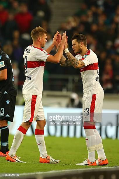 Simon Terodde changes with Daniel Ginczek of Stuttgart during the Second Bundesliga match between VfB Stuttgart and TSV 1860 Muenchen at MercedesBenz...