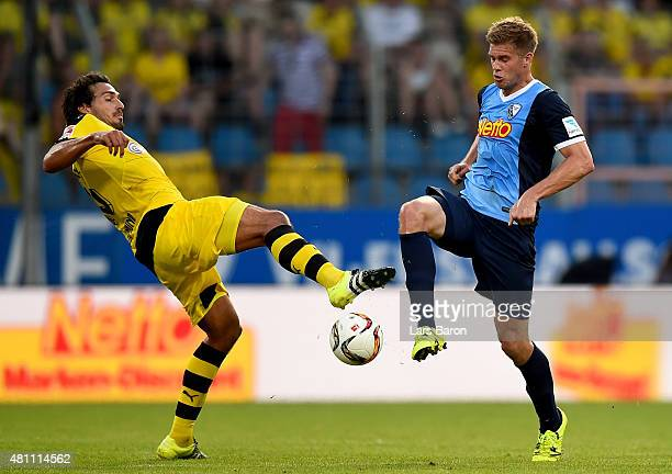 Simon Terodde of Bochum is challenged by Mats Hummels of Dortmund during a preseason friendly match between VfL Bochum and Borussia Dortmund at...