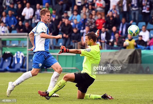 Simon Terodde of Bochum scores his teams second goal past goalkeeper Sven Ulreich of Stuttgart during the DFB Cup first round match between VfL...