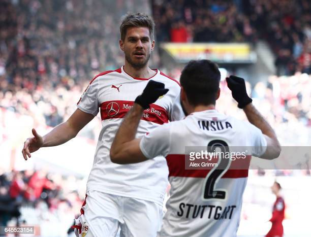 Simon Terodde of Stuttgart celebrates scoring his teams goal with Emiliano Adriano Insa during the Second Bundesliga match between VfB Stuttgart and...