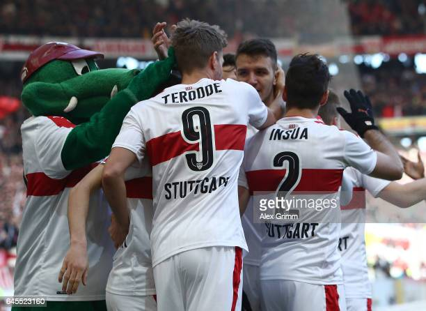 Simon Terodde of Stuttgart celebrates scoring his teams goal with teamates and the club mascot during the Second Bundesliga match between VfB...