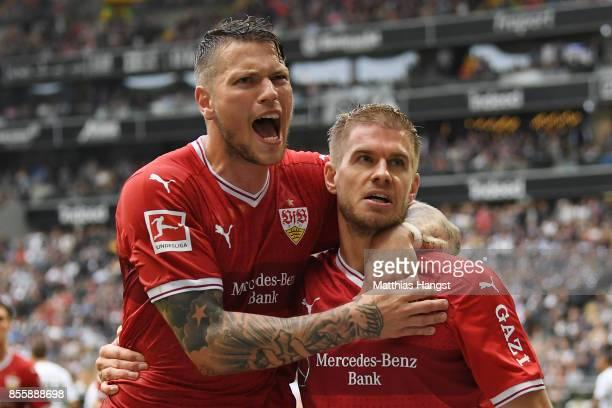 Simon Terodde of Stuttgart celebrates with Daniel Ginczek of Stuttgart after he scored his teams first goal to make it 11 during the Bundesliga match...