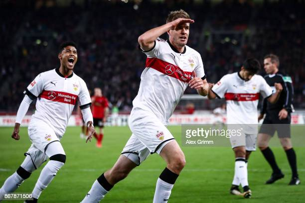 Simon Terodde of Stuttgart celebrates with his teammates after scoring his team's third goal to make it 30 during the Bundesliga match between VfB...