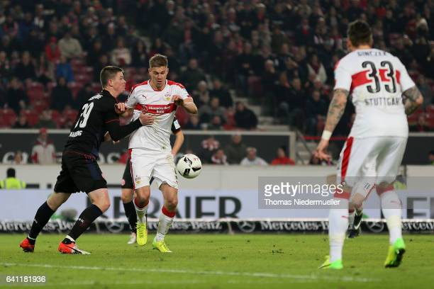 Simon Terodde of Stuttgart fights for the ball with Alexander Madlung of Duesseldorf during the Second Bundesliga match between VfB Stuttgart and...