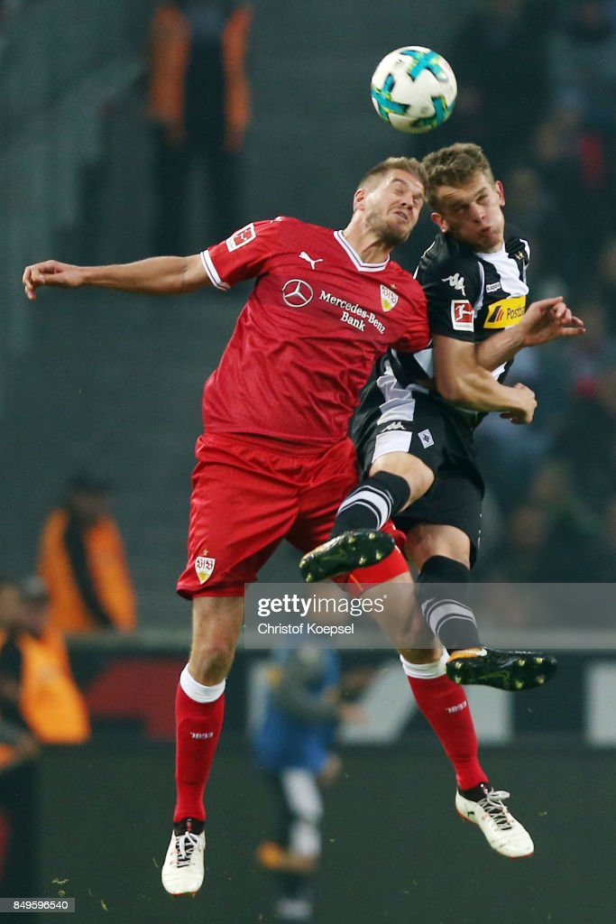 Simon Terodde of Stuttgart (l) fights for the ball with Matthias Ginter of Moenchengladbach during the Bundesliga match between Borussia Moenchengladbach and VfB Stuttgart at Borussia-Park on September 19, 2017 in Moenchengladbach, Germany.