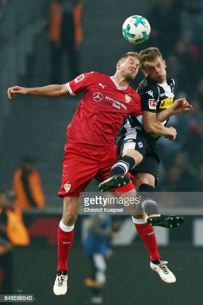 Simon Terodde of Stuttgart fights for the ball with Matthias Ginter of Moenchengladbach during the Bundesliga match between Borussia Moenchengladbach...