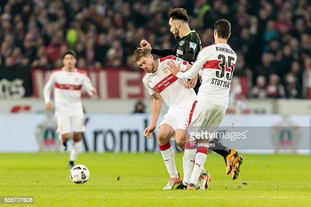 Simon Terodde of Stuttgart Marcin Kaminski of Stuttgart and Kenan Karaman of Hannover battle for the ball during the Second Bundesliga match between...