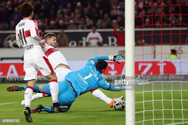 Simon Terodde of Stuttgart scores his team's first goal against goalkeeper Philipp Tschauner of Hannover during the Second Bundesliga match between...