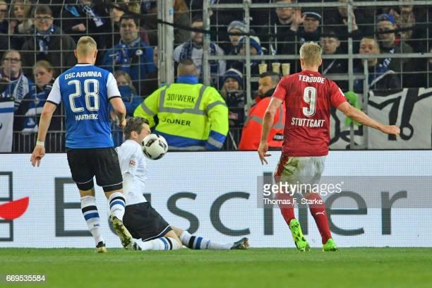 Simon Terodde of Stuttgart scores the winning goal against Daniel Davari of Bielefeld during the Second Bundesliga match between DSC Arminia...