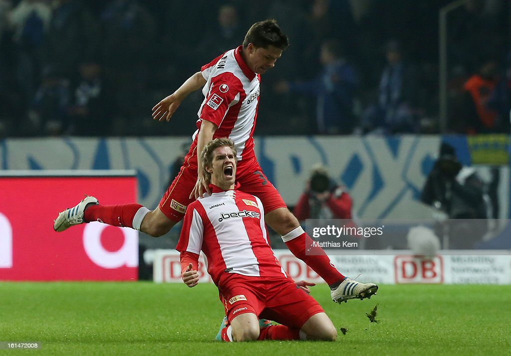 Simon Terodde (R) of Union jubilates with team mate Fabian Schoenheim (L) after scoring the first goal during the Second Bundesliga match between Hertha BSC Berlin and 1.FC Union Berlin at Olympic Stadium on February 11, 2013 in Berlin, Germany.