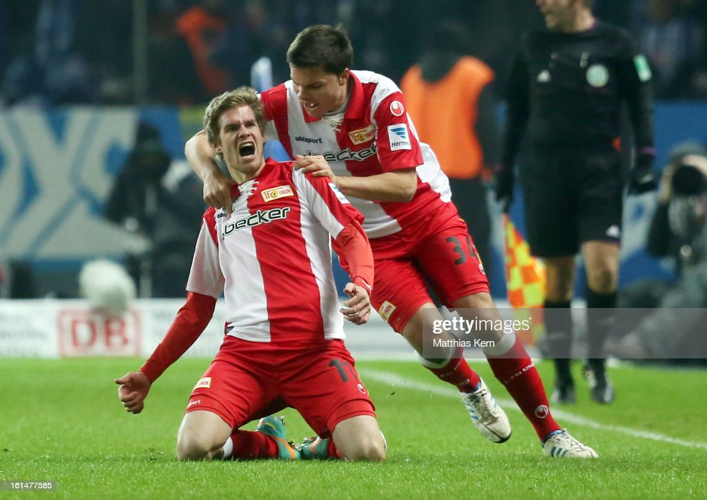 Simon Terodde (L) of Union jubilates with team mate Fabian Schoenheim (R) after scoring the first goal during the Second Bundesliga match between Hertha BSC Berlin and 1.FC Union Berlin at Olympic Stadium on February 11, 2013 in Berlin, Germany.