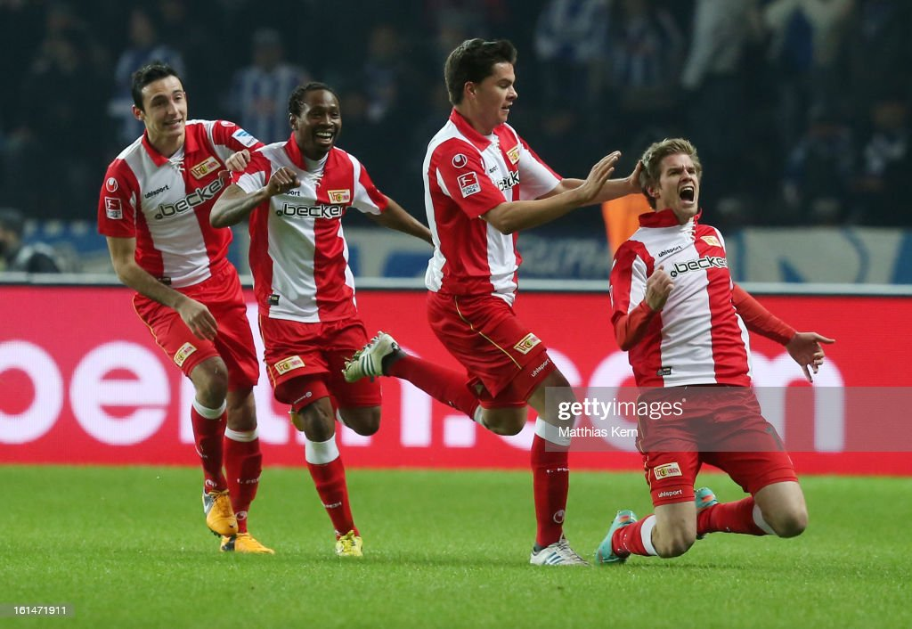 Simon Terodde (R) of Union jubilates with team mates after scoring the first goal during the Second Bundesliga match between Hertha BSC Berlin and 1.FC Union Berlin at Olympic Stadium on February 11, 2013 in Berlin, Germany.