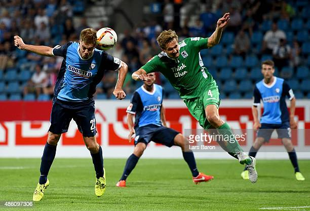 Simon Terodde of VfL Bochum goes up for a header with Kai Bulow of TSV 1860 Muenchen during the Second Bundesliga match between VfL Bochum and 1860...