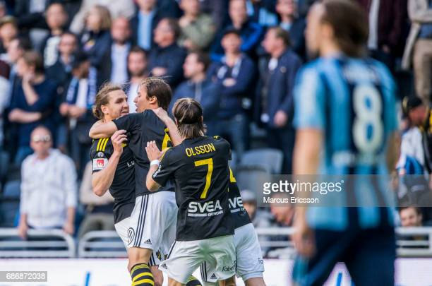 Simon Thern of AIK celebrates together with NilsEric Johansson after scoring 10 during the Allsvenskan match between Djurgardens IF and AIK at Tele2...