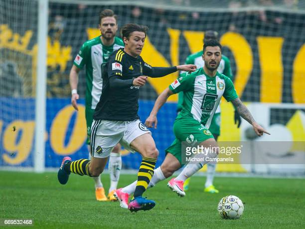 Simon Thern of AIK in a duel with Jiloan Hamad of Hammarby IF during an Allsvenskan match between AIK and Hammarby IF at Friends arena on April 17...