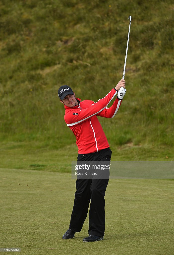 <a gi-track='captionPersonalityLinkClicked' href=/galleries/search?phrase=Simon+Thornton&family=editorial&specificpeople=3965505 ng-click='$event.stopPropagation()'>Simon Thornton</a> of Ireland hits his 2nd shot on the 13th hole during the Second Round of the Dubai Duty Free Irish Open Hosted by the Rory Foundation at Royal County Down Golf Club on May 29, 2015 in Newcastle, Northern Ireland.