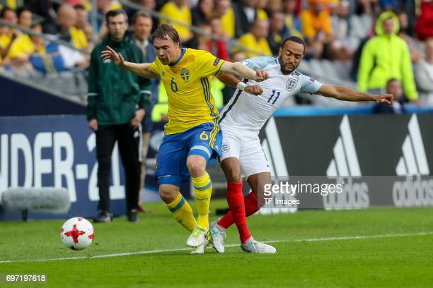 Simon Tibbling of Sweden and Nathan Redmond of England battle for the ball during the UEFA European Under21 Championship match between Sweden and...