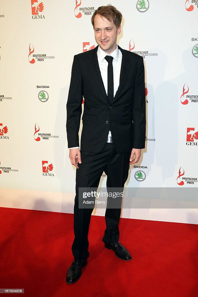 Simon Triebel arrives for the Deutscher Musikautorenpreis (German Songwriter Prize) 2013 ceremony at the Ritz Carlton hotel on April 25, 2013 in Berlin, Germany. The prize has been presented by GEMA (Gesellschaft fuer musikalische Auffuehrungs- und mechanische Vervielfaeltigungsrechte), the German society for musical performing and mechanical reproduction rights, since 2009.