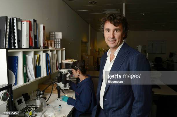 Simon Trott managing director of salt uranium and borates at Rio Tinto Group poses for a photograph in a laboratory associated with the company's...
