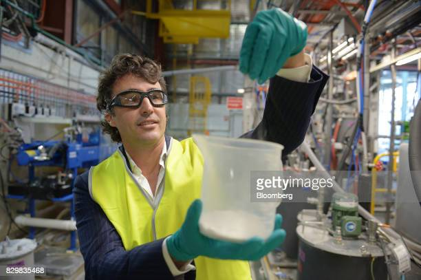 Simon Trott managing director of salt uranium and borates at Rio Tinto Group displays lithium ore for a photograph inside the company's Bundoora...