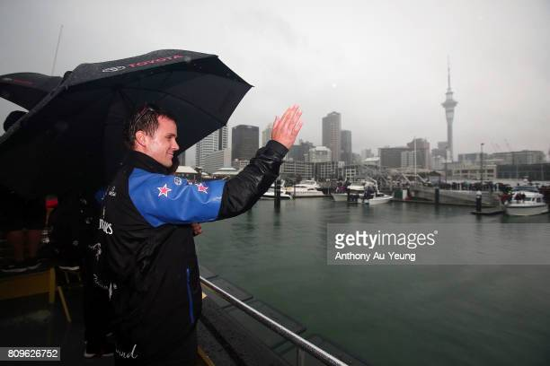 Simon van Velthooven cyclist of Emirates Team New Zealand waves to the supporters during the Team New Zealand Americas Cup Welcome Home Parade on...