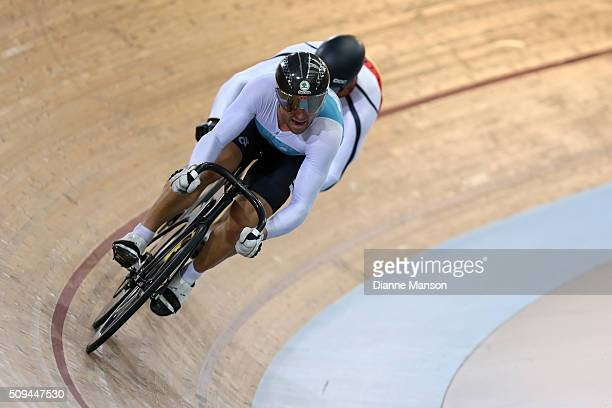 Simon van Velthooven of West Coast North Island competes against Matthew Archibald of Southland in the Elite Men Sprint during the New Zealand Track...