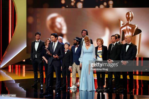 Simon Verhoeven on stage with cast and crew after receiving his award for Largest Audience for the film 'Willkommen bei den Hartmanns' at the Lola...