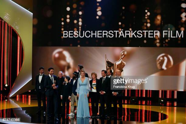 Simon Verhoeven on stage with cast and crew after receiving his Award for Highest grossing Film of the Year for the film 'Willkommen bei den...