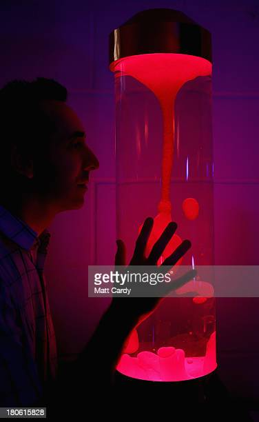 Simon Waters looks at an original 1960's lava lamp at the Mathmos factory on September 12 2013 in Poole England The company based in Poole Dorset has...