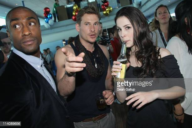 Simon Webbe and Lee Ryan of the UK band Blue chat with German singer Lena MeyerLandrut of Germany while sailing on a ship on the Rhine River during...