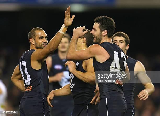 Simon White of the Blues celebrates with his Chris Yarran after kicking a goal during the round 16 AFL match between the Carlton Blues and the St...
