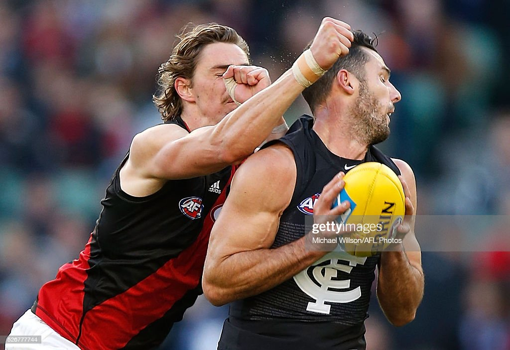 Simon White of the Blues is taken high by Joe Daniher of the Bombers during the 2016 AFL Round 06 match between the Carlton Blues and the Essendon Bombers at the Melbourne Cricket Ground, Melbourne on May 1, 2016.
