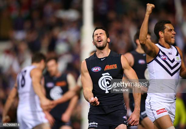 Simon White of the Blues reacts after the final siren during the round 19 AFL match between the Fremantle Dockers and the Carlton Blues at Patersons...