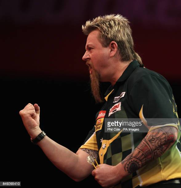 Simon Whitlock Celebrates against Dave Chisnall during the Ladbrokescom World Darts Championship at Alexandra Palace London