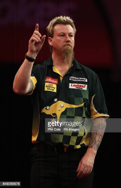 Simon Whitlock celebrates beating Dave Chisnall during the Ladbrokescom World Darts Championship at Alexandra Palace London