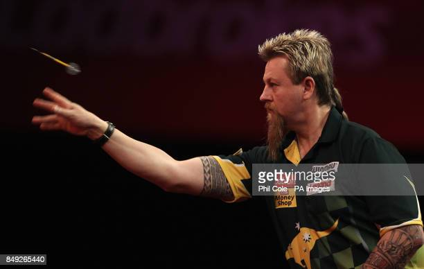Simon Whitlock in action against Dave Chisnall during the Ladbrokescom World Darts Championship at Alexandra Palace London