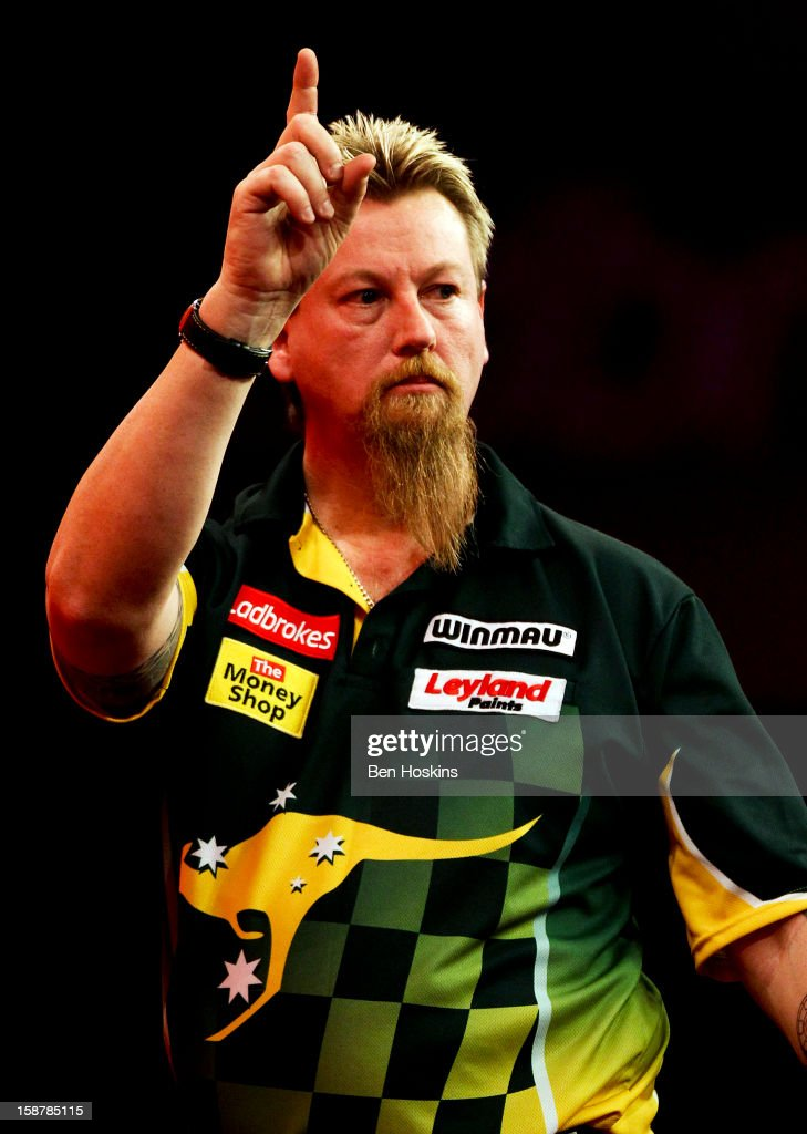 Simon Whitlock of Australia celebrates during his quarter final match against Raymond van Barneveld of the Netherlands on day twelve of the 2013 Ladbrokes.com World Darts Championship at the Alexandra Palace on December 28, 2012 in London, England.