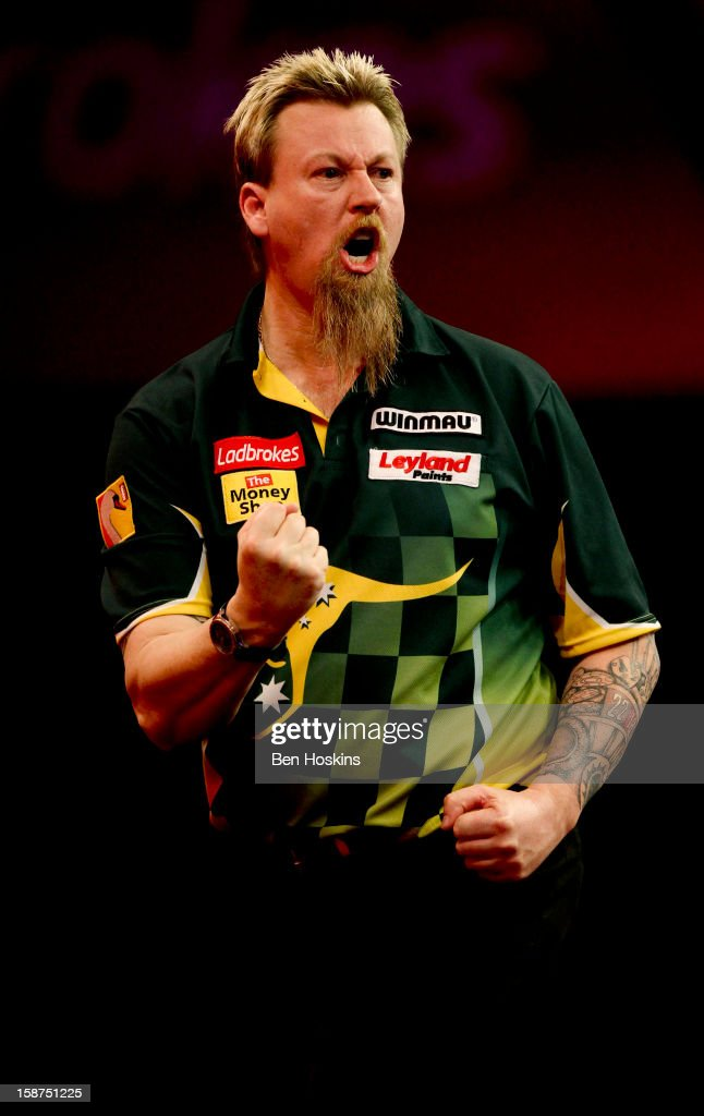 <a gi-track='captionPersonalityLinkClicked' href=/galleries/search?phrase=Simon+Whitlock&family=editorial&specificpeople=2098061 ng-click='$event.stopPropagation()'>Simon Whitlock</a> of Australia celebrates during his third round match against Dave Chisnall on day eleven of the 2013 Ladbrokes.com World Darts Championship at the Alexandra Palace on December 27, 2012 in London, England.