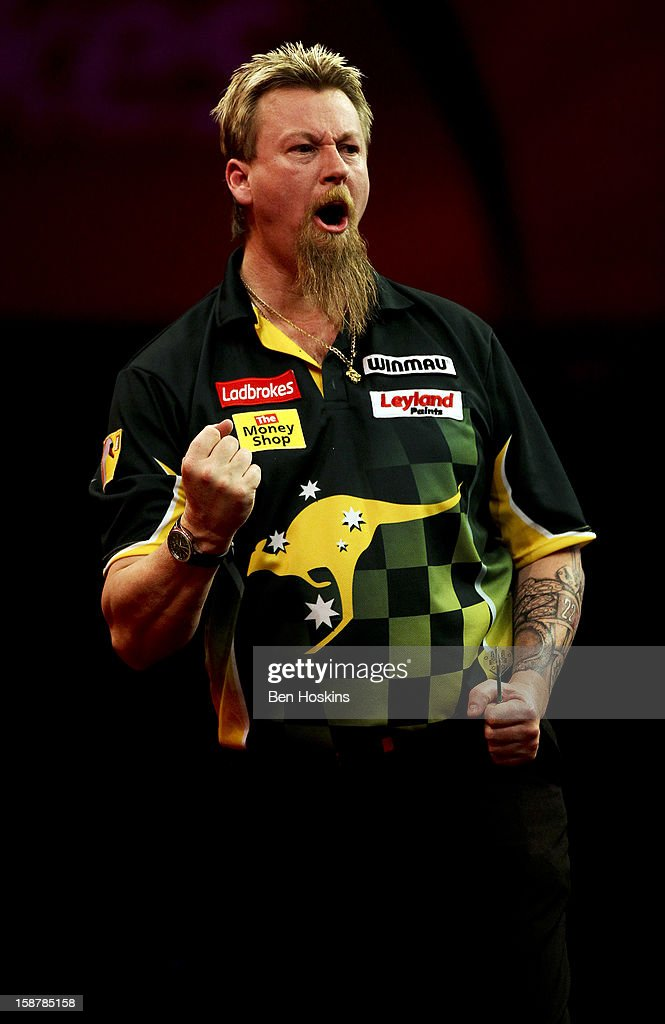 Simon Whitlock of Australia celebrates taking the third set during his quarter final match against Raymond van Barneveld of the Netherlands on day twelve of the 2013 Ladbrokes.com World Darts Championship at the Alexandra Palace on December 28, 2012 in London, England.