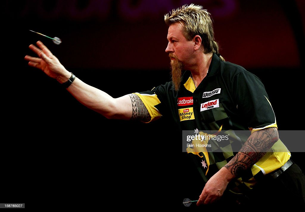 <a gi-track='captionPersonalityLinkClicked' href=/galleries/search?phrase=Simon+Whitlock&family=editorial&specificpeople=2098061 ng-click='$event.stopPropagation()'>Simon Whitlock</a> of Australia in action during his quarter final match against Raymond van Barneveld of the Netherlands on day twelve of the 2013 Ladbrokes.com World Darts Championship at the Alexandra Palace on December 28, 2012 in London, England.